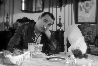 Jean Dujardin is upstaged by Uggie in a scene from The Artist